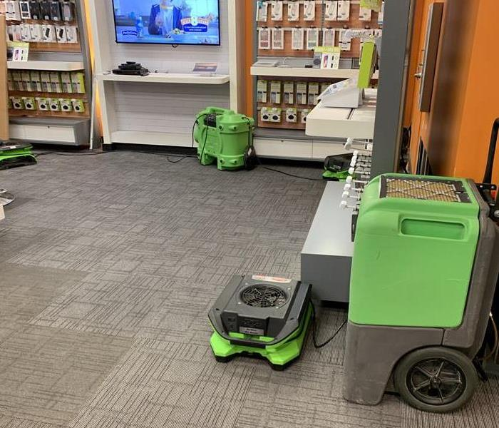 Green air movers on the carpet floor.
