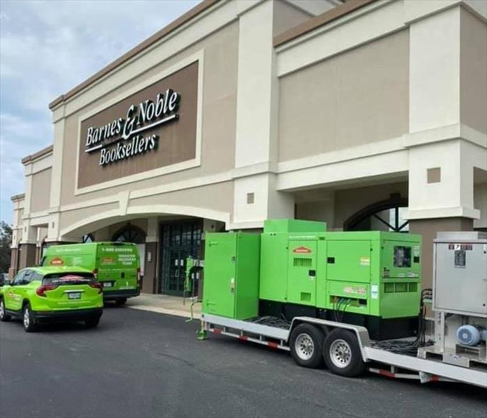 Green SERVPRO vehicles outside a Barnes and Noble.