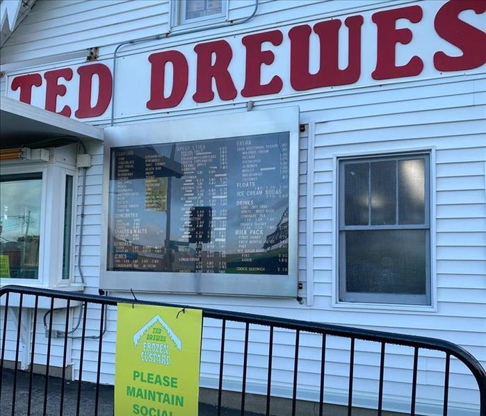 Ted Drewes with a Certified: SERVPRO Cleaned sign.