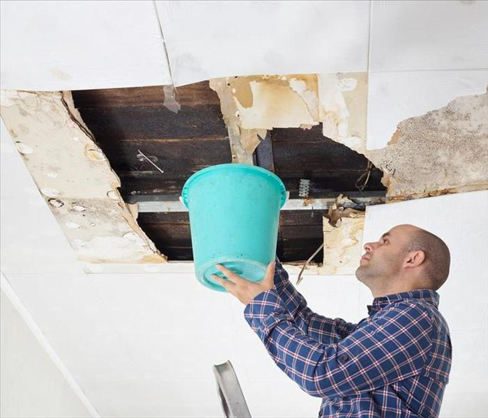 Ceiling panels damaged huge hole in roof from rainwater leakage
