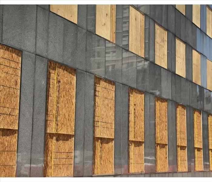 Windows and doors boarded in a building